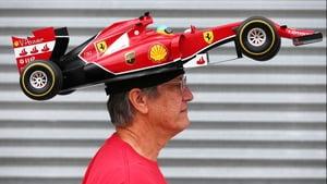 Ferrari fan Kim Reiner walks through the paddock ahead of the Canadian Grand Prix