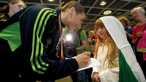 Katie Taylor signs an autograph for Grace Carruth on her triumphant return from the European Championships on Sunday