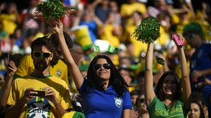Brazil fans do the same in the sunshine