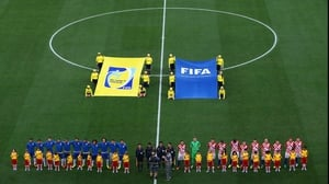 The Brazil and Croatia squads line up before the match kicks off