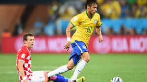 Neymar runs down the pitch, hunting for a seam in the defence