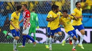 Neymar and his team-mates celebrate his goal