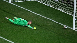 Croatia's goalkeeper Stipe Pletikosa extends but misses Neymar's strike
