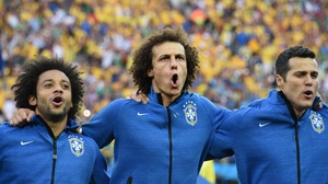 Brazilian defenders David Luiz and Marcello proudly sing their national anthem