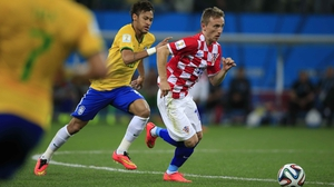 Croatian midfielder Luka Modric drives upfield, while being chased by Neymar