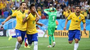 Neymar celebrates with his fellow Brazilians while Pletikosa grieves the goal scored
