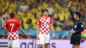 Nishimura grants Fred's request, handing a yellow card to Croatian defender Dejan Lovren