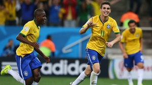 Oscar celebrates, as Brazil exits the first day of World Cup action with a solid three points to their name