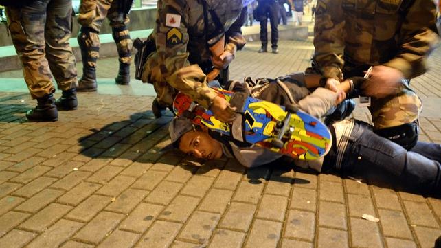 A demonstrator is arrested in Belo Horizonte
