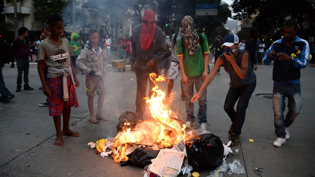 Angry protesters burn rubbish on the streets of Belo Horizonte