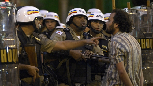 A protester confronts police in Belo Horizonte