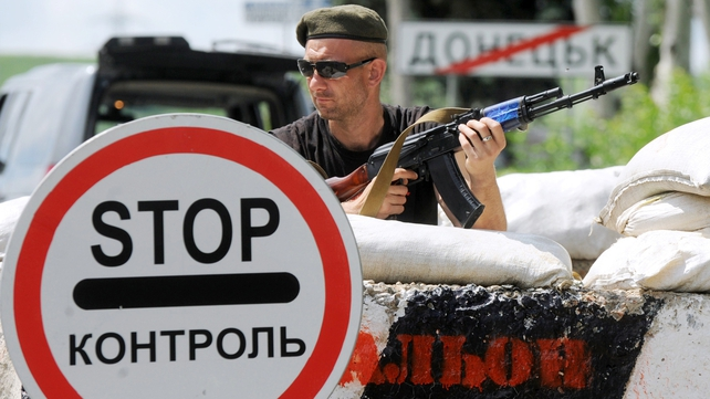 A pro-Russian militant guards a checkpoint on the road between Donetsk and Mariupol earlier this month