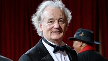 Bill Murray throws fans' phones off rooftop