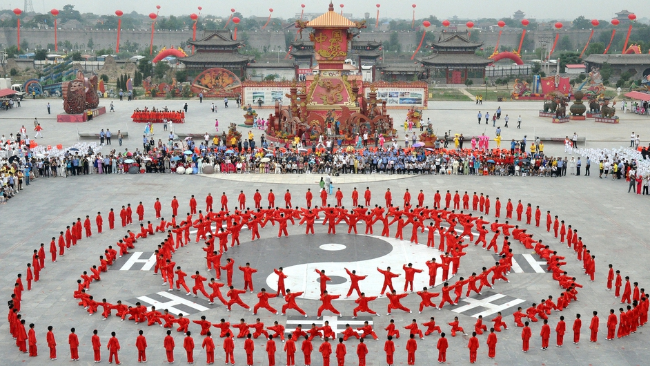 People perform tai chi during the launching ceremony of the 12th Handan International Tai Chi Conference in Handan north China
