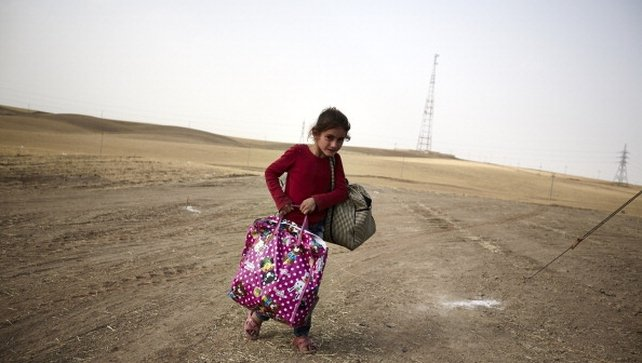 An Iraqi girl fleeing from the city of Mosul arrives at a Kurdish checkpoint