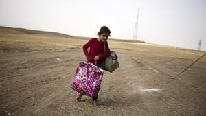An Iraqi girl fleeing from the city of Mosul arrives at a Kurdish checkpoint.