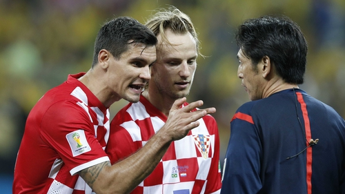 Ivan Rakitic (R) limped out of the win against Spain