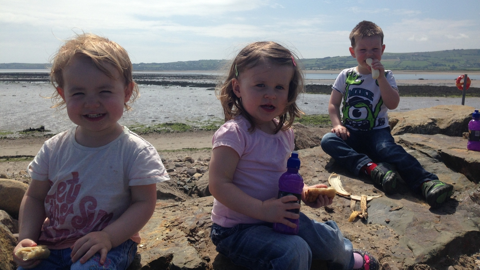 Emma, Chloe and Adam enjoying the sun at Abbeyside beach, Co Waterford (Pic: Patrick Kenealy)