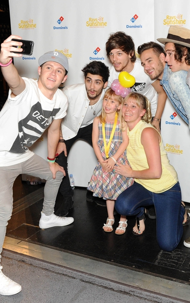 One Direction pose for photographs  as they made the wishes of 60 seriously ill children come true.