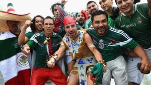 Mexican fans prepare to enter Arena Das Dunas, where their team faced Cameroon- in a tropical rainstorm