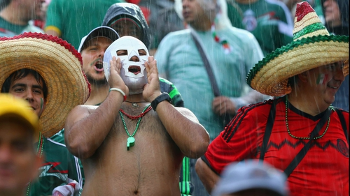 Day 2 of the World Cup was an utter blitz: Mexico persevered through some sketchy calls, Netherlands pounded Spain in a resounding upset and Chile held off a pesky Australia side