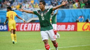 Mexican midfielder Giovani dos Santos reacts after an offside call disallowed his 13' goal