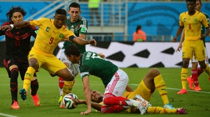Cameroon's veteran forward Samuel Eto'o works to make something of a chaotic situation on Mexico's goal-line