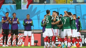 Peralta and his team-mates celebrate the goal