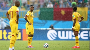 Eto'o looks dejected after Mexico pulls ahead during the rainy match play