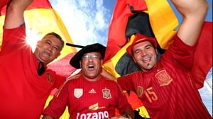 Moving to Salvador, fans of Spain celebrate their squad's impending match against The Netherlands, which began at 2000