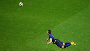 A short while later, Netherlands captain forward Robin van Persie earns a new moniker - 'The Flying Dutchman' - after his spectacular goal at 44' - from 17 yards out no less