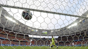 From behind the net, Spanish veteran goalkeeper captain Iker Casillas looks with disbelief as the header floats in