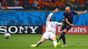 Soon after halftime, Dutch forward Arjen Robben blasts a tricky ball past the Spanish defence at 53' to claim the lead at 2-1