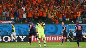 Following another score from Van Persie nine minutes later, Casillas laments his fourth goal conceded on the night
