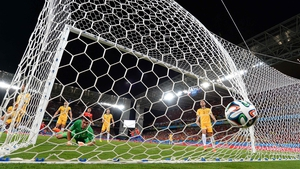 Australia goalkeeper Maty Ryan looks on, as the ball hits the back of the net