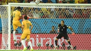 Not out of it yet though, Australia bid their time and came roaring back at 35' with a classic leaping header from veteran forward Tim Cahill