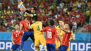 Chile goalkeeper Claudio Bravo worked to hold off the pesky Aussies right up to the end...