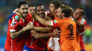 Yet, it was Chile's night in the end, as midfielder Jean Beausejour (second from left) knocked in a final goal in extra time to solidify the winning score at 3-1