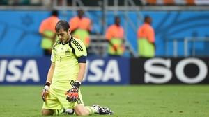 Iker Casillas reacts after Arjen Robben, not seen, scored his team's fifth goal