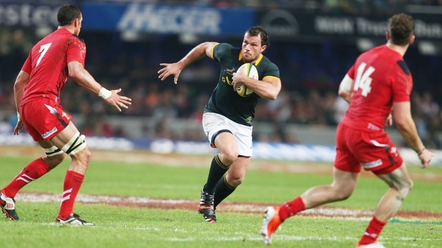 South Africa's Bismarck du Plessis charges at the Wales de