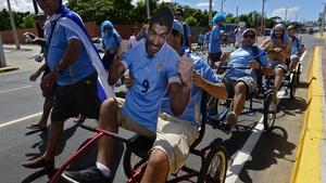 Uruguayan fans drive tricycles carrying a portrait of Luis Suarez, near Castelao Stadium in Fortaleza ahead of Uruguay vs Costa Rica