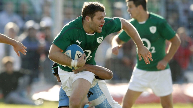 Ireland's Darren Cave is tackled by an Argentina defender