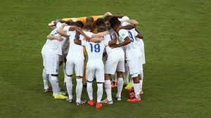 England huddle before their game with Italy
