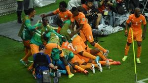 Ivory Coast celebrate with winning goalscorer Gervinho