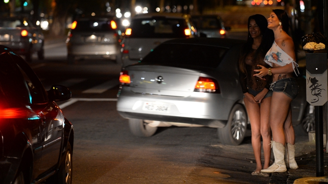 A sex worker and a tranvestite wait for clients in the streets of Belo Horizonte