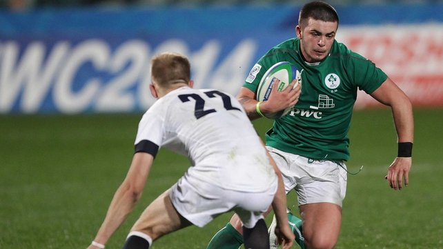 Ireland's Ryan Foley is tackled by Sam Olver of England