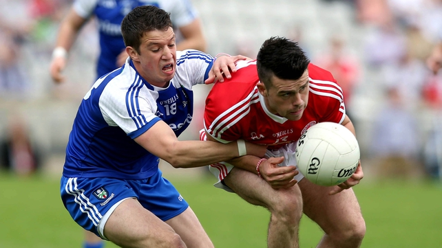 Darren McCurry of Tyrone with Gerard McCaffrey of Monaghan