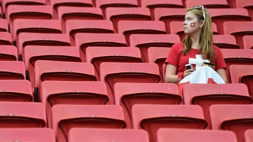 A Swiss fan waits for the game to kick off