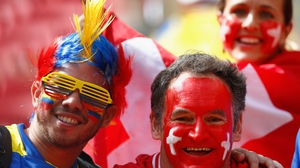 Here we go! Switzerland and Ecuador fans gear up for the game