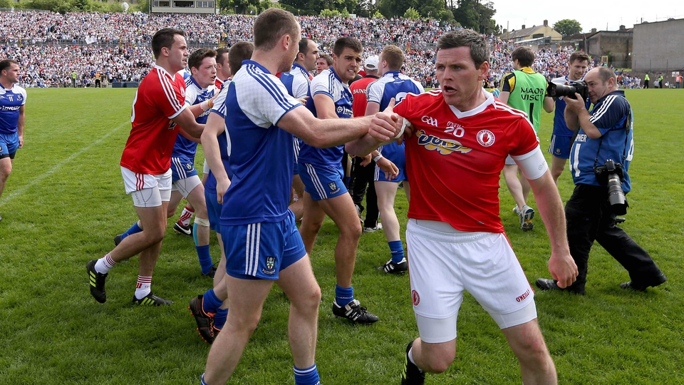 Conor Gormley of Tyrone and Vinny Corey of Monaghan pictured during a fractious end to the Ulster Football Championship quarter-final game